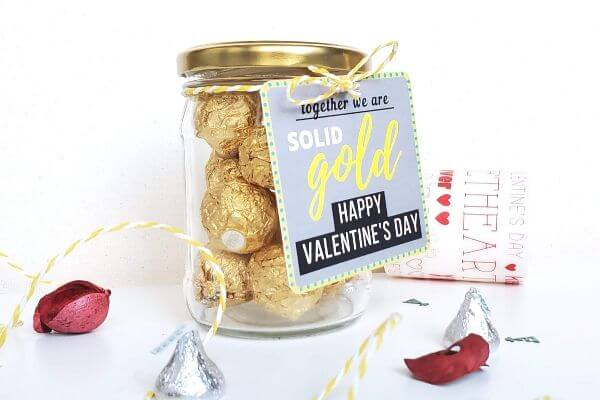 DIY Jar of Chocolate With Valentine's Day Gift Tag That Says Together We Are Solid Gold